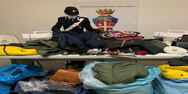 Napoli: i CC sequestrano laboratorio di capi contraffatti e denunciano un uomo